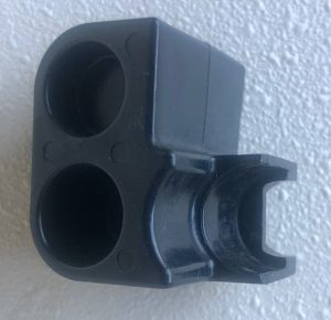 Plastic piece that holds the throttle and shift barrels in place.
